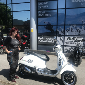 Charlotte collecting her Vespa GTS Super 300