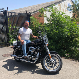 Dennis collecting his Harley Davidson Super Low